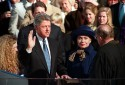 "William Jefferson ""Bill"" Clinton, with his wife Hillary Rodham Clinton and daughter Chelsea at his side, takes the oath of office as 42nd president of the United States from Chief Justice William H. Rehnquist on the west steps of the Capitol in Washington Wednesday, Jan. 20, 1993. (AP Photo/Ed Reinke)"